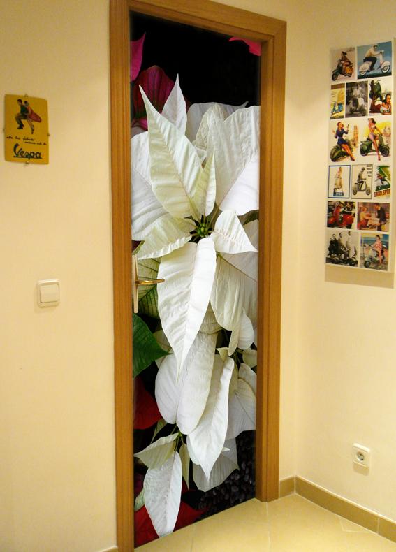 Navidad en tus puertas doordresser for Fotos de puertas decoradas de navidad